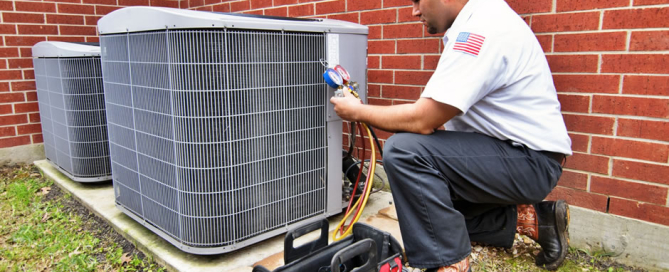 trained technician repairing air conditioner